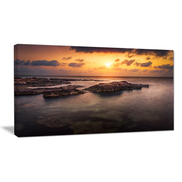 Sunset over African Seashore Photographic Print on Wrapped Canvas by Design Art