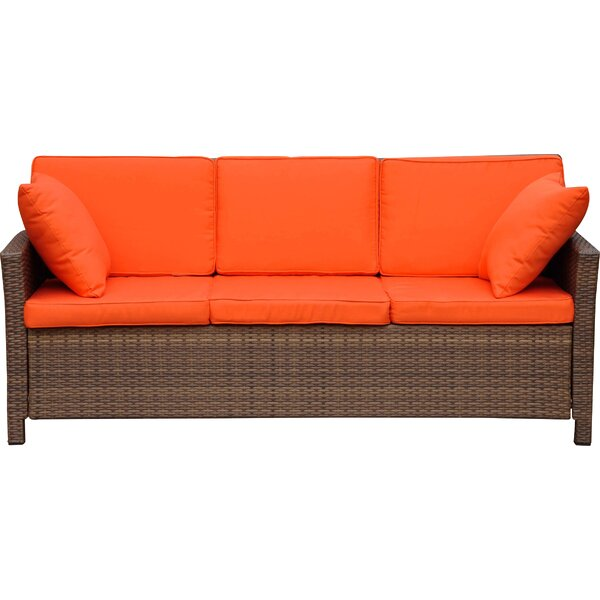 Stapleton Wicker Resin Sofa with Cushions by Charlton Home