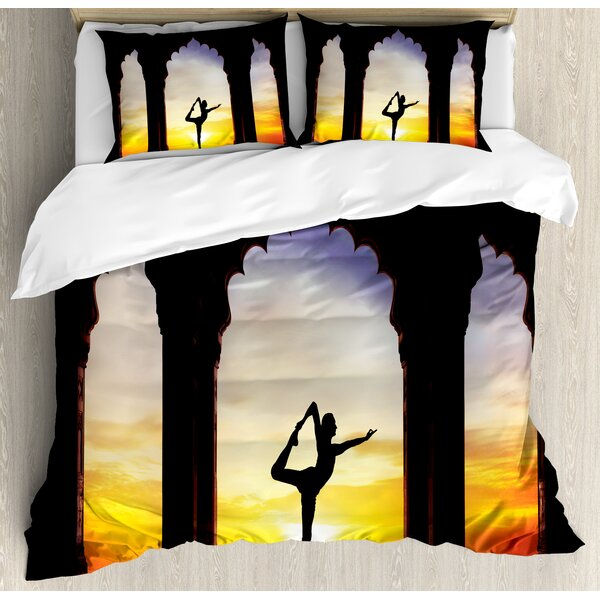 Man Silhouette Doing Yoga in Old Ancient Temple at Sunset Mental Meditative Duvet Set by East Urban Home