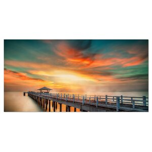 Wooden Bridge under Colorful Sky Sea Bridge Photographic Print on Wrapped Canvas by Design Art