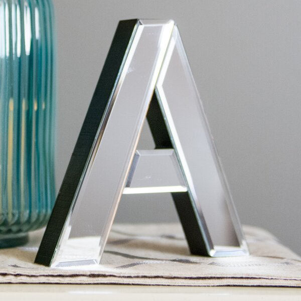 A Glass Letter Block by Boston Warehouse Trading Corp