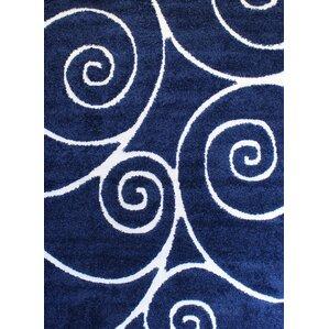 quaoar shaggy swirls navy blue area rug