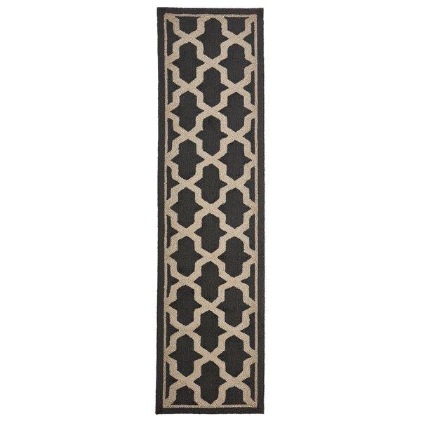 This Elam Geo Hand-Woven Brown Indoor/Outdoor Area Rug