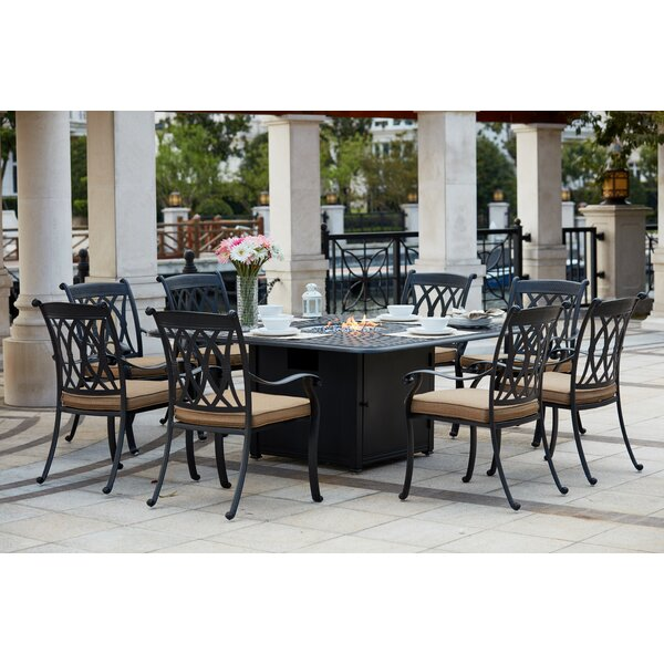 Melchior Traditional 9 Piece Dining Set with Cushions by Astoria Grand