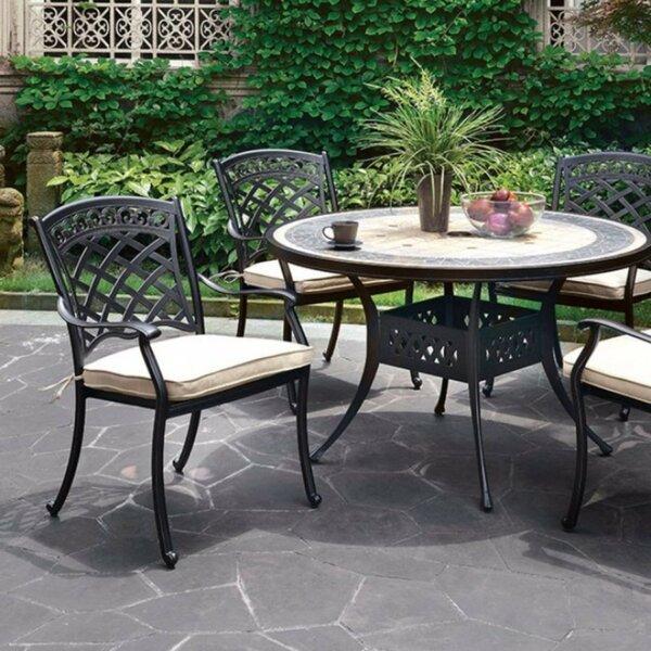 Coury Stone/Concrete Dining Table by Fleur De Lis Living