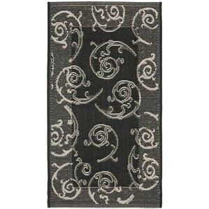 short blacksand swirl area rug
