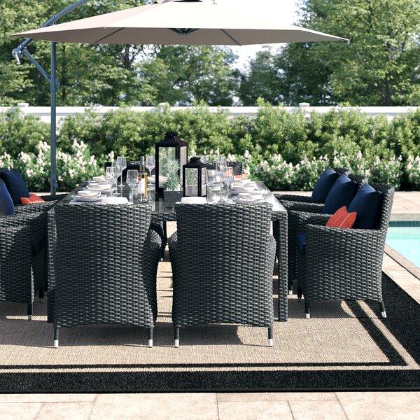 Tripp 11 Piece Dining Set with Sunbrella Cushions by Brayden Studio