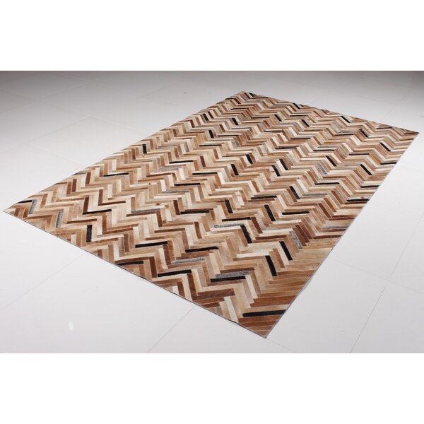 Manley Hide Cowhide Brown Area Rug by Orren Ellis