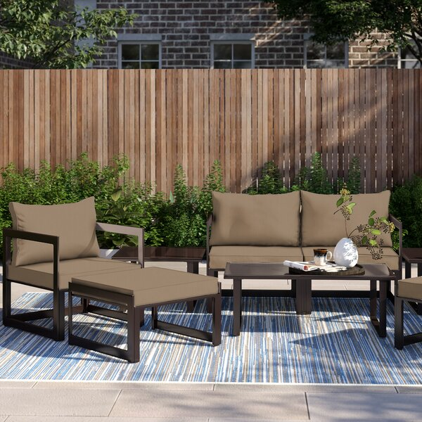 Annemarie Outdoor Patio 9 Piece Sectional Seating Group with Cushions by Foundstone