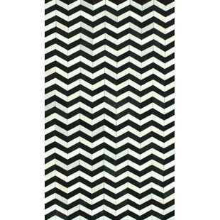 Favermann Patchwork Hand-Woven Cowhide Black/White Area Rug ByOrren Ellis