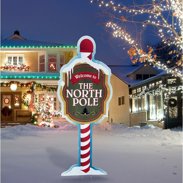 North Pole Yard Sign by The Holiday Aisle