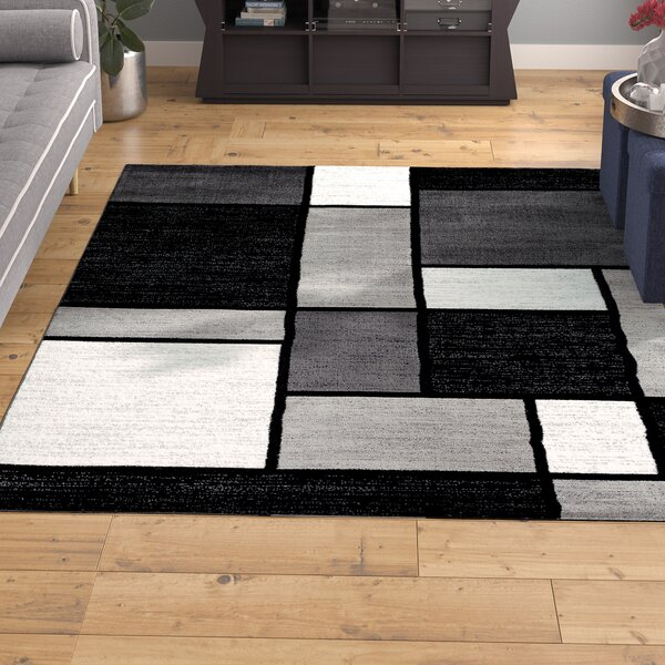 Lorenzo Gray/Black Area Rug by Wade Logan