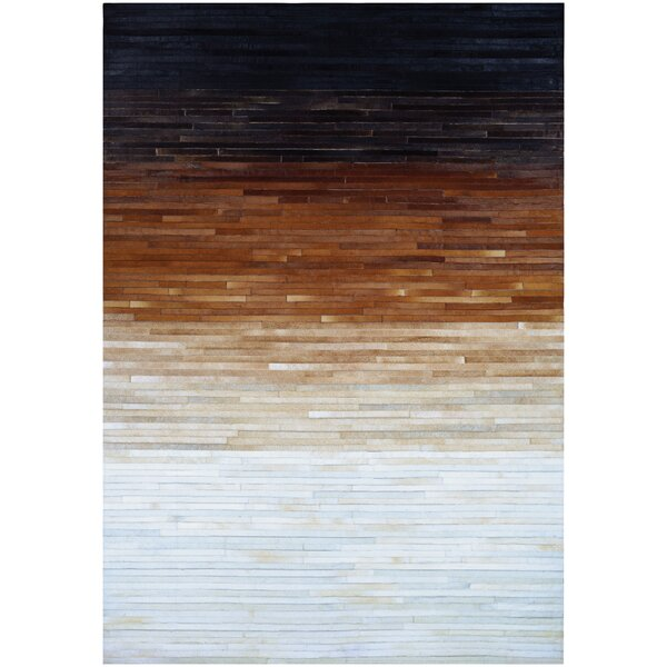 Ashlie Flat-woven Cowhide Black/Brown/Beige Area Rug by Union Rustic
