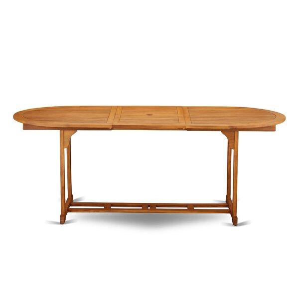 Rahul Solid Wood Dining Table by Longshore Tides