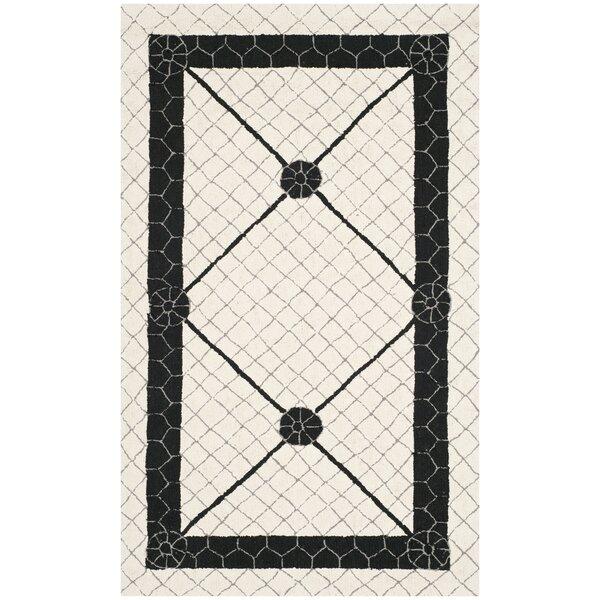 Parish Ivory/Black Geometric Area Rug by Charlton Home