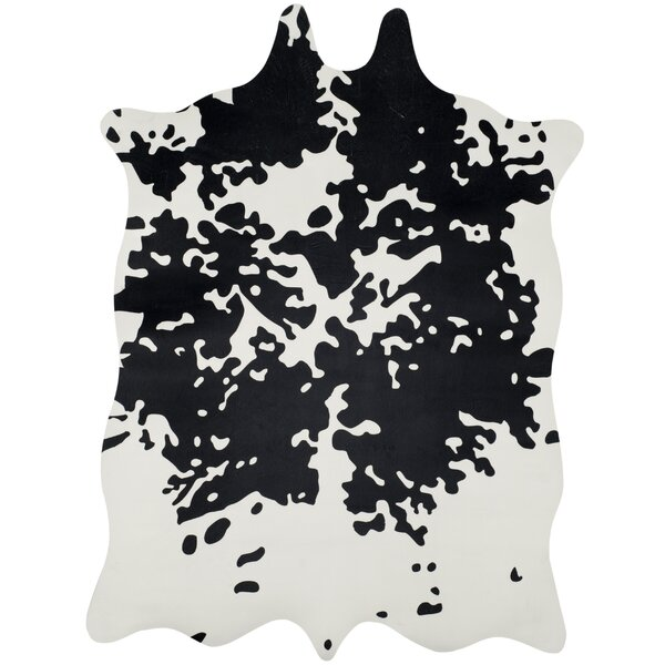 Faux Hide Hand-Tufted Black/White Area Rug by Safavieh