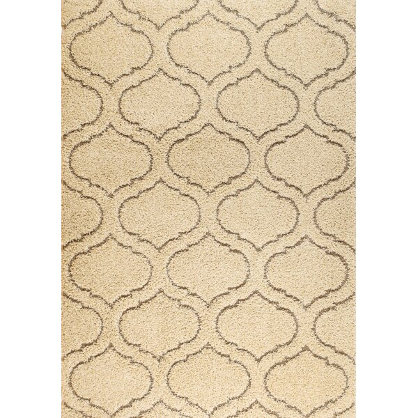 Quaoar Cream Area Rug by Wrought Studio