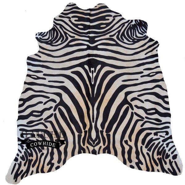 Eastlake Jorgenson Stenciled Zebra Black/White Cowhide Area Rug by Isabelline