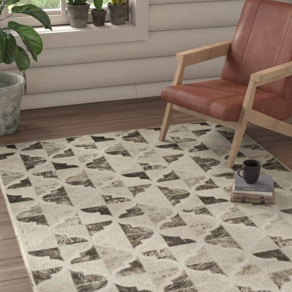 Caigan Dark Brown/Black Area Rug by Loon Peak