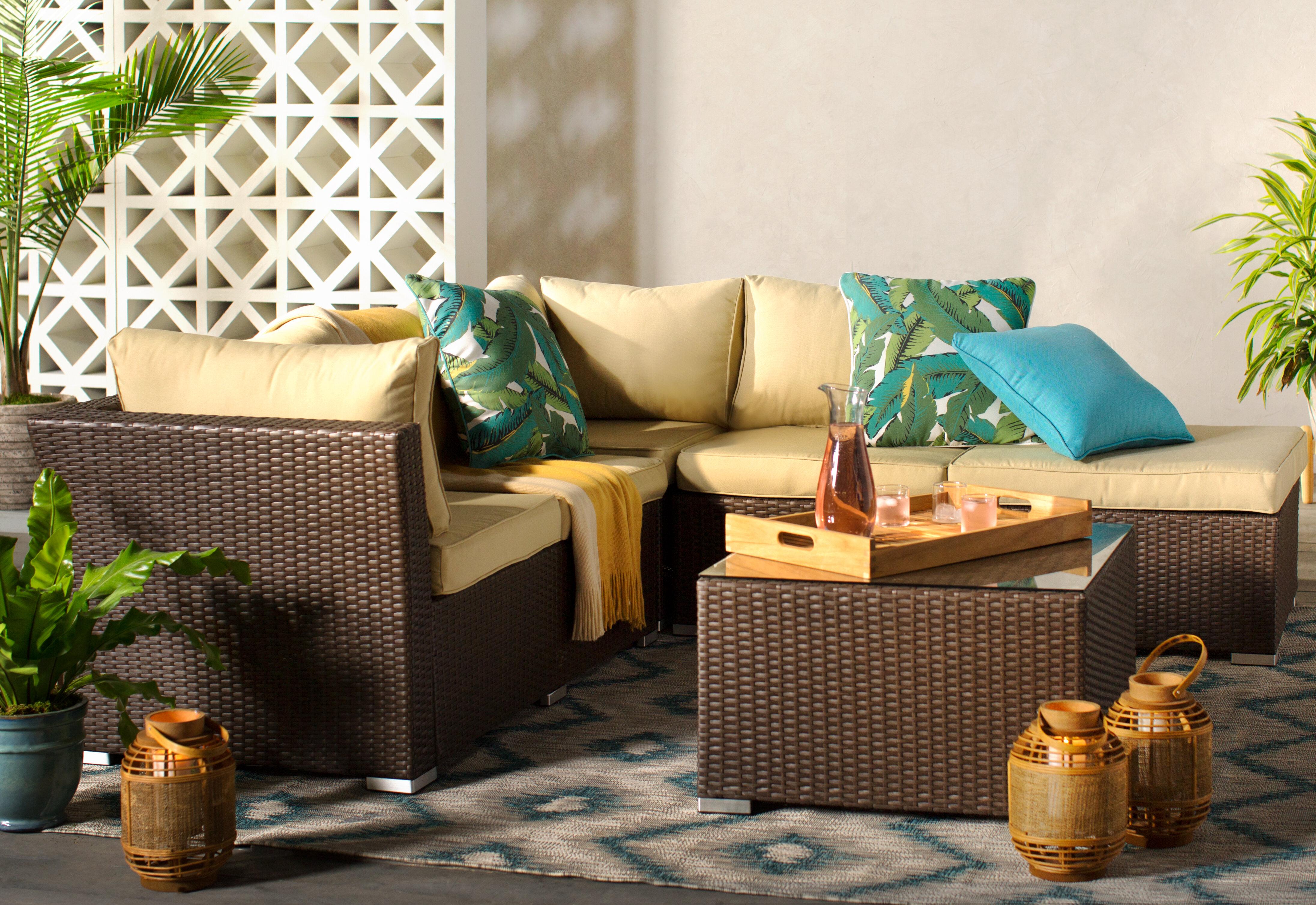 deck idea featuring a wicker outdoor conversation set
