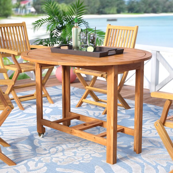 Alanna Solid + Manufactured Wood Dining Table by Beachcrest Home Beachcrest Home