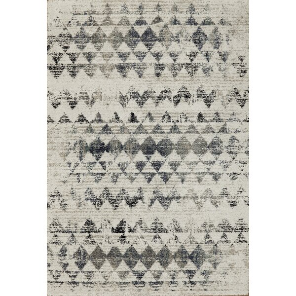 Lucina Ivory Area Rug by Wrought Studio