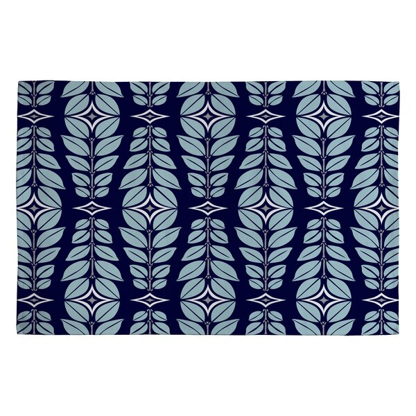 Heather Dutton Cortlan Navy Yard Blue Floral Area Rug by Deny Designs