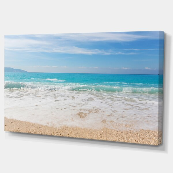 White Waves Kissing Beach Sand Large Seashore Photographic Print on Wrapped Canvas by Design Art