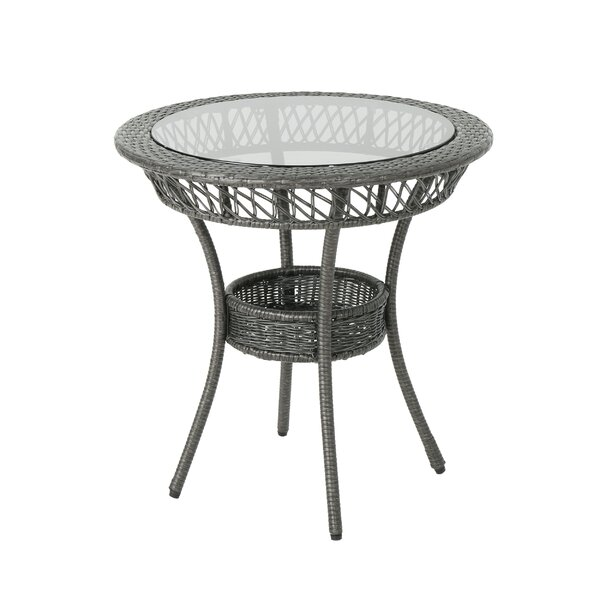 Postel Fisher Outdoor Glass Top Wicker Dining Table by August Grove