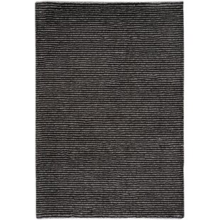 Looking for Gravitation Black Area Rug By Capel Rugs