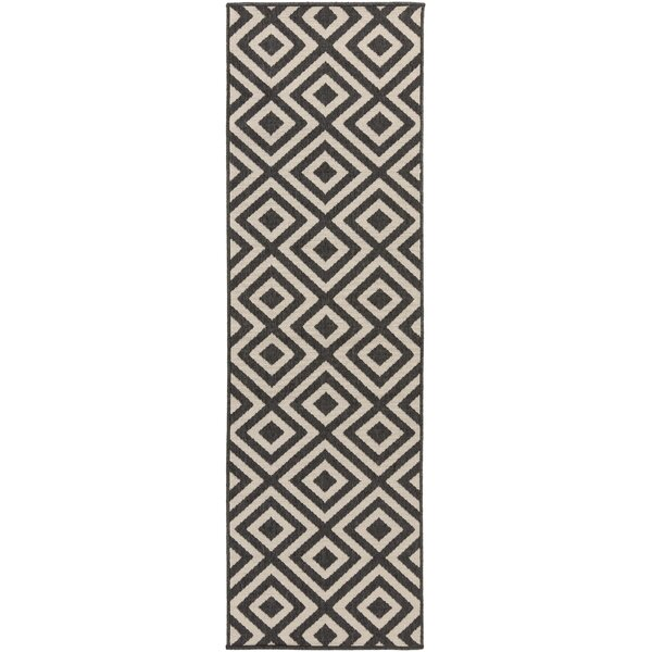 Files Hand-Woven Black/Cream Outdoor Area Rug by Wrought Studio
