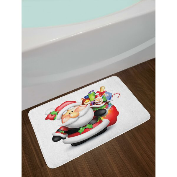 Whimsical Cartoon Father Xmas with Pinkish Cheeks and Bag Full of Fun Present Toys Bath Rug by East Urban Home