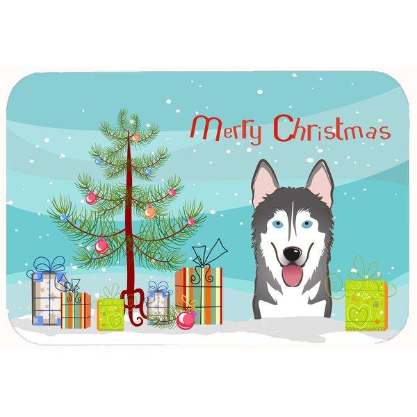Christmas Tree and Alaskan Malamute Kitchen/Bath Mat by The Holiday Aisle