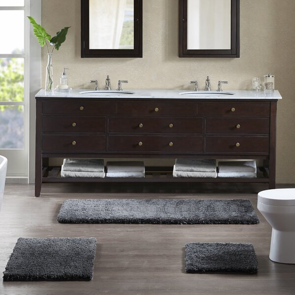 Grande Solid Tufted Bath Rug By Madison Park Signature.