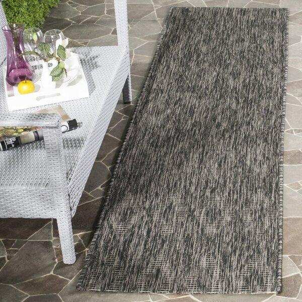 Lefferts Black Indoor/Outdoor Area Rug by Wrought Studio