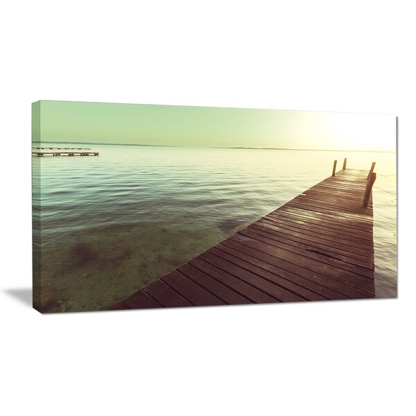 Wooden Boardwalk over Clear Waters Photographic Print on Wrapped Canvas by Design Art