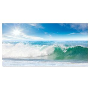 White and Blue Waves under Sun Seashore Photographic Print on Wrapped Canvas by Design Art