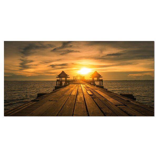 Huge Wooden Bridge to Illuminated Sky Photographic Print on Wrapped Canvas by Design Art