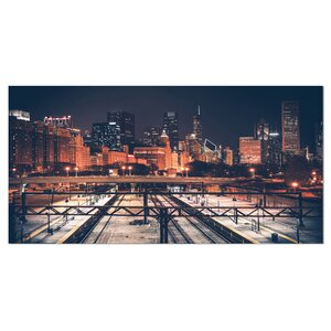 Dark Chicago Skyline and Railroad Cityscape Photographic Print on Wrapped Canvas by Design Art