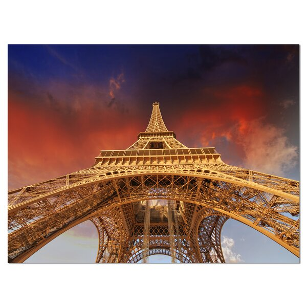 Beautiful View of Paris Eiffel Tower Under Red Sky Cityscape Photographic Print on Wrapped Canvas by Design Art