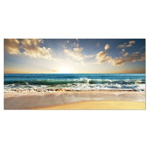 Cloudy Sky and Vibrant Blue Sea Seashore Photographic Print on Wrapped Canvas by Design Art