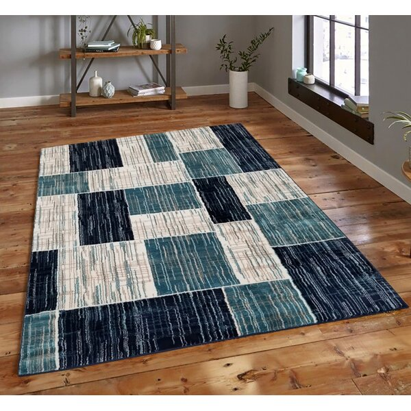 Melvern Geometric Tufted Blue Indoor / Outdoor Area Rug