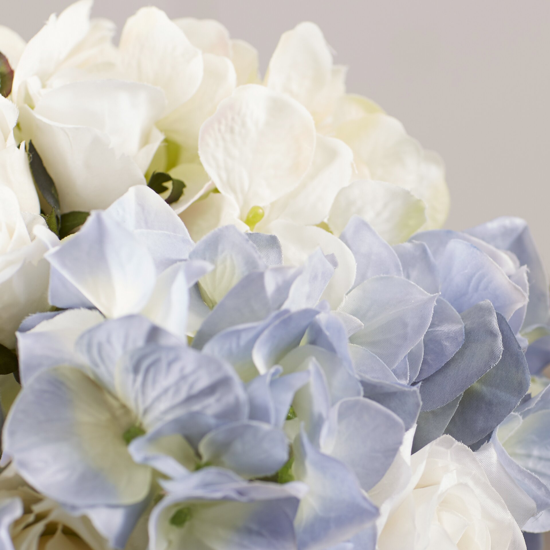 Lark manor millau hydrangea and rose bouquet in water