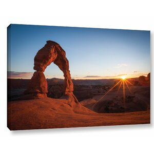 'Delicate Arch with Sunburst' by Cody York Photographic Print on Wrapped Canvas by Loon Peak