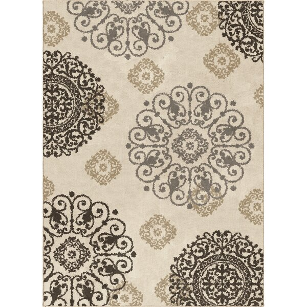 Reynolds Ivory Area Rug by Three Posts