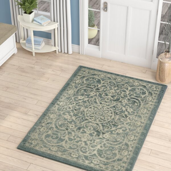 Landen Turquoise/Ivory Area Rug by Charlton Home