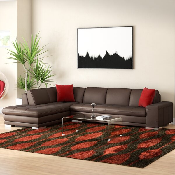 Helmer Sectional by Wade Logan