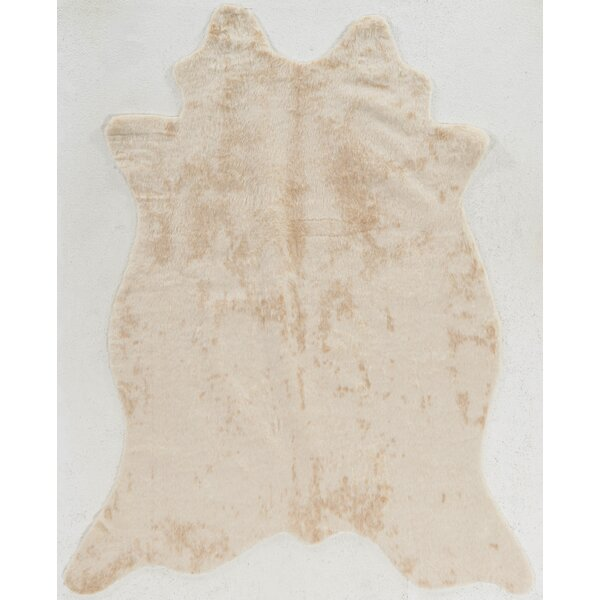 Hand-Tufted Faux Cowhide Ivory Area Rug by Mercury