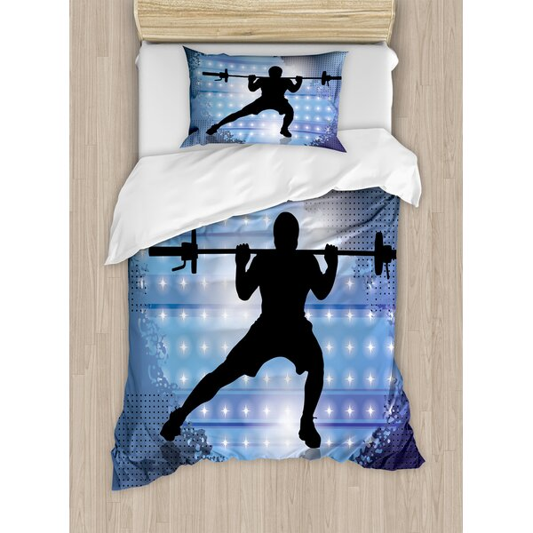 Silhouette of Weightlifter on Abstract Backdrop with Stars Champion Duvet Set by East Urban Home