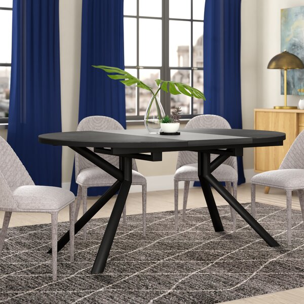 Meadowbrook Round Extendable Dining Table by Orren Ellis